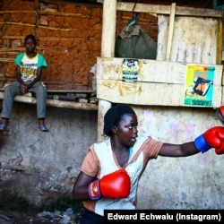 A female boxer trains at a gym in Uganda. (Photo: Edward Echwalu)