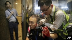 attacker bites politician's ear in hong kong