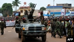 Rebel Seleka coalition soldiers arrive in Bangui, March 30, 2013. The Central African Republic's new strongman Michel Djotodia vowed Saturday not to contest 2016 polls and hand over power at the end of the three-year transition he declared after his coup