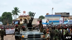 Rebel Seleka coalition soldiers arrive in Bangui, March 30, 2013.