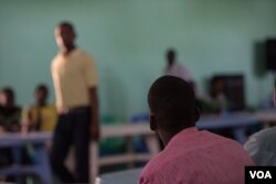 A teacher, himself a former Al-Shabab member, instructs fellow defectors at a rehabilitation center for former militants in Baidoa, Somalia, Sept. 17, 2016. (Photo: J. Patinkin/VOA)