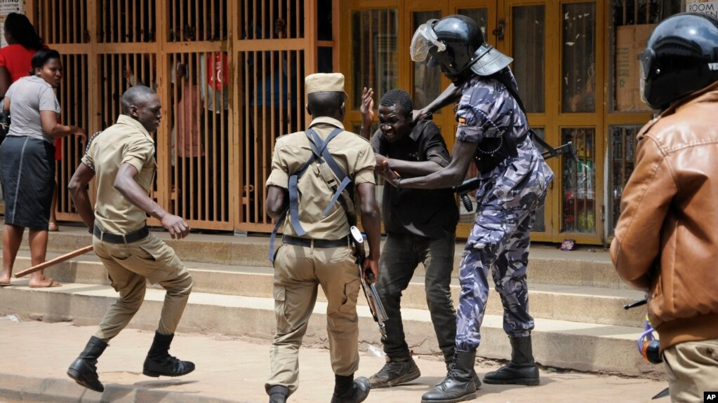 file ugandan security forces briefly beat then detain a protester in downtown kampala uganda