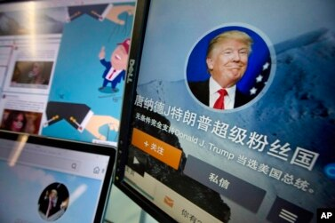 "Chinese fan websites for Donald Trump are displayed on a computer with the words ""Donald J. Trump super fan nation, Full and unconditional support for Donald J. Trump to be elected U.S. president"" in Beijing, China, May 18, 2016. China features prominently in the rhetoric of presumed Republican presidential candidate Donald Trump, who accuses the country of stealing American jobs and cheating at global trade."