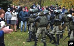 People argue with policemen during an opposition rally to protest the official presidential election results in Minsk, Belarus, Nov. 1, 2020.