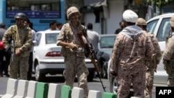 FILE - Members of the Iranian Revolutionary Guard are seen in Tehran, June 7, 2017.