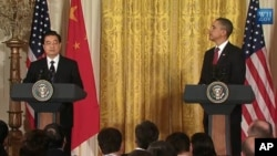 奥巴马和胡锦涛在记者会上