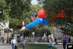 A giant inflatable Superman flies past the U.S. embassy on Balloon Day Parade in Brussels, Sept. 2013.