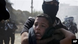 An Israeli Arab boy is detained by Israeli riot police during clashes in the northern Israeli town of Umm el-Fahm, Wednesday, Oct. 27, 2010