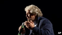 "Five Stars Movement party leader Beppe Grillo speaks at a rally on constitutional reforms, in Rome, Italy, Nov. 26, 2016. He has called Italy under Prime Minister Matteo Renzi ""a country that's stuck in the mud."""