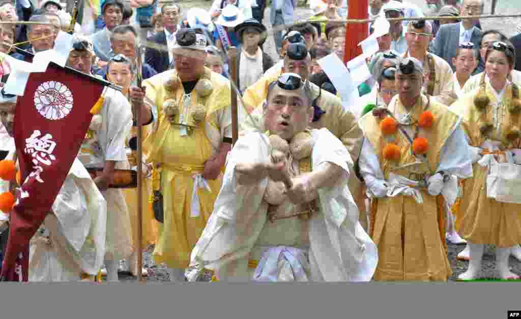 Yamabushi or Japanese Buddhist monks in the mountains hold a ceremony of official opening of Mount Fuji climbing season at Murayama Sengen Shrine in Fujinomiya, Shizuoka prefecture.