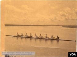 Yale's 1880 varsity crew team in the New Haven harbor. Chung Mun Yew is at the helm. (Manuscripts and Archives, Yale University)