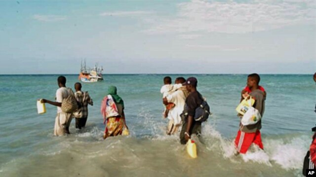 People waiting to board a boat to take them across the Gulf of Aden (file photo)
