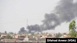 이라크 북부 투즈 쿠르마투 지역에서 연기가 치솟고 있다. (자료사진)