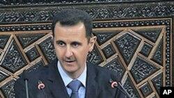 叙利亚总统阿萨德在对全国电视讲话