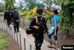 FILE - Riot police patrol in front of the court building during a protest to demand the release of demonstrators detained during protests against Nicaraguan President Daniel Ortega's government, in Managua, Nicaragua Oct. 10, 2018.