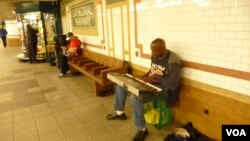 New York subway musician Christopher Campbell thanks his mother for the gift of a spiritual life. (VOA/A. Phillips)