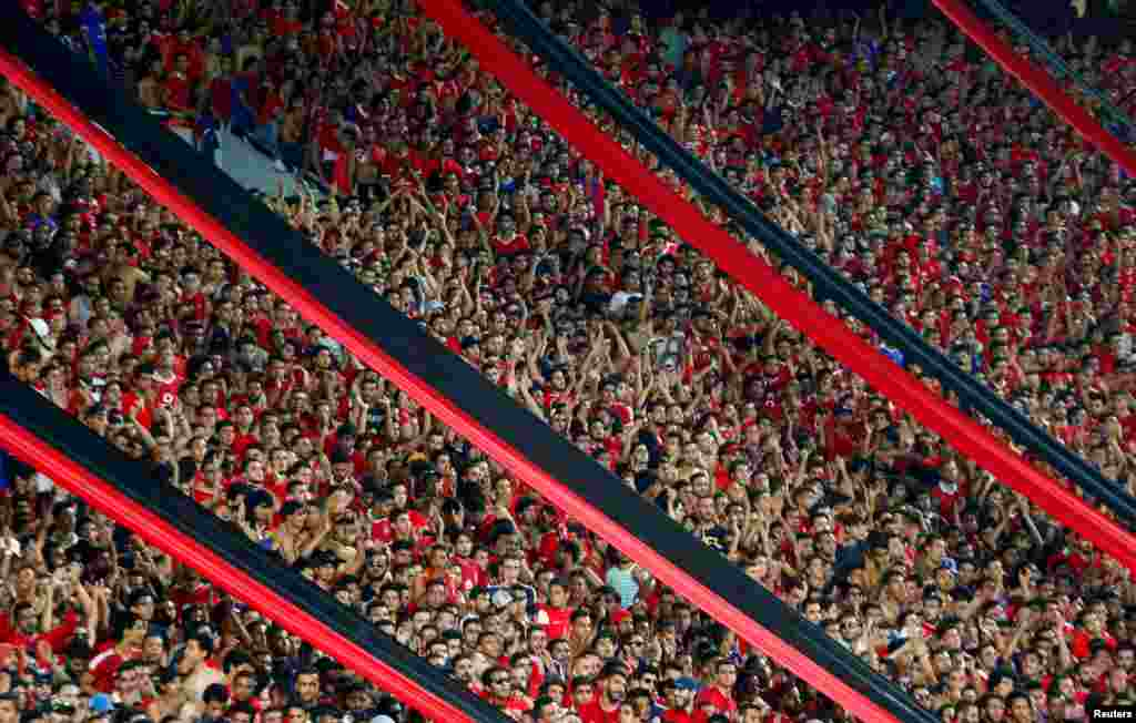 Football fans cheer during the CAF Champions League semi-final football match between Al Ahly and Etoile du Sahel at the Borg El Arab Stadium in Alexandria, Egypt, Oct. 22, 2017.