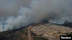 A Canadian Joint Operations Command aerial photo shows wildfires near neighborhoods in Fort McMurray, Alberta. (CF Operations)