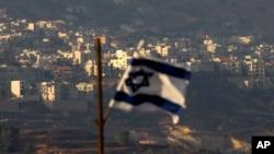 FILE - An Israeli flag flies near the Golan Heights village of Majdal Shams, Oct. 11, 2018.
