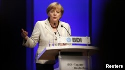 German Chancellor Angela Merkel gives a speech during the Federation of German Industries annual meeting in Berlin, September 25, 2012.