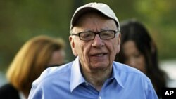 Rupert Murdoch, Australian-American media mogul and the chairman and chief executive of News Corporation, arrives at the Sun Valley Inn in Sun Valley, Idaho, July 7, 2011