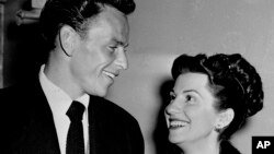 FILE - Singer Frank Sinatra and his wife Nancy smile broadly as they leave a Hollywood night club following a surprise meeting, Oct. 23, 1946. Nancy Sinatra Sr., the childhood sweetheart of Frank Sinatra has died. She was 101.