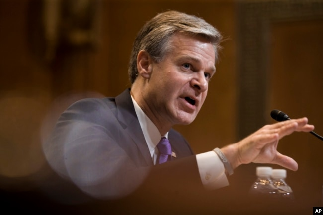 FILE - FBI Director Christopher Wray testifies during a hearing on Capitol Hill, May 7, 2019.