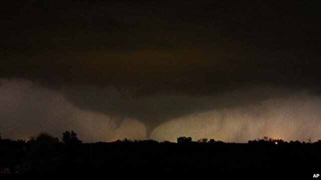 A tornado on the ground makes it way through the night near Salin, Kansas, during the third day of severe weather and multiple tornado sightings, April 14, 2012.