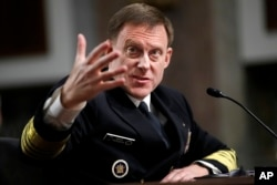 U.S. Cyber Command and the National Security Agency Director Adm. Mike Rogers testifies on Capitol Hill in Washington, Tuesday, May 9, 2017, before the Senate Armed Services Committee. Wednesday he spoke in support of making Section 702 of FISA program permanent.