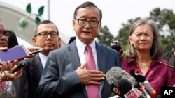 Cambodia's exiled opposition leader Sam Rainsy talks to the media outside Parliament House in Kuala Lumpur, Malaysia, Tuesday, Nov. 12, 2019.