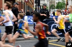 Armed police guard the area during the Great Manchester Run in Manchester, England, May 28, 2017.