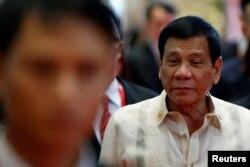FILE - Philippines' President Rodrigo Duterte arrives at the East Asia Summit in Vientiane, Laos, Sept. 8, 2016.