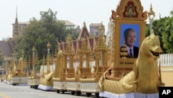 The royal funeral convoys are prepared ahead of the funeral procession for Cambodia's late King Norodom Sihanouk Thursday, Jan. 31, 2013, in Phnom Penh, Cambodia. The body of Sihanouk who died on Oct. 15, 2012 at age 89 is scheduled to be cremated on Feb. 4, 2013. (AP Photo/Heng Sinith)