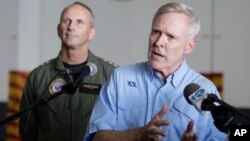 FILE - Secretary of the Navy, Ray Mabus, right, gestures during a press conference.