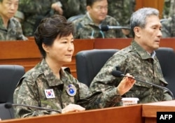 This handout photo released by the presidential Blue House shows South Korea's President Park Geun-Hye (L) during her visit to the headquarters of Third Army in Yongin, south of Seoul, on August 21, 2015.