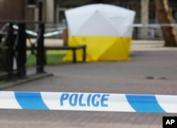 """A police tent covers the spot in Salisbury, Britain, March 6, 2018, where former Russian double agent Sergei Skripal and his daughter Yulia were found critically ill. """"unknown substance."""""""