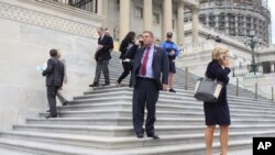 Members of Congress depart the Capitol in Washington, after last votes Friday, Sept. 25, 2015.