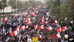 Thousands of anti-government protesters march to the Saudi embassy in Manama, March 15, 2011