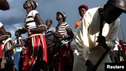 People dance during celebrations to commemorate the second anniversary of South Sudan's independence, Juba, July 9, 2013.