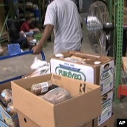 Workers box food items at the MANNA food center in Gaithersburg, Maryland