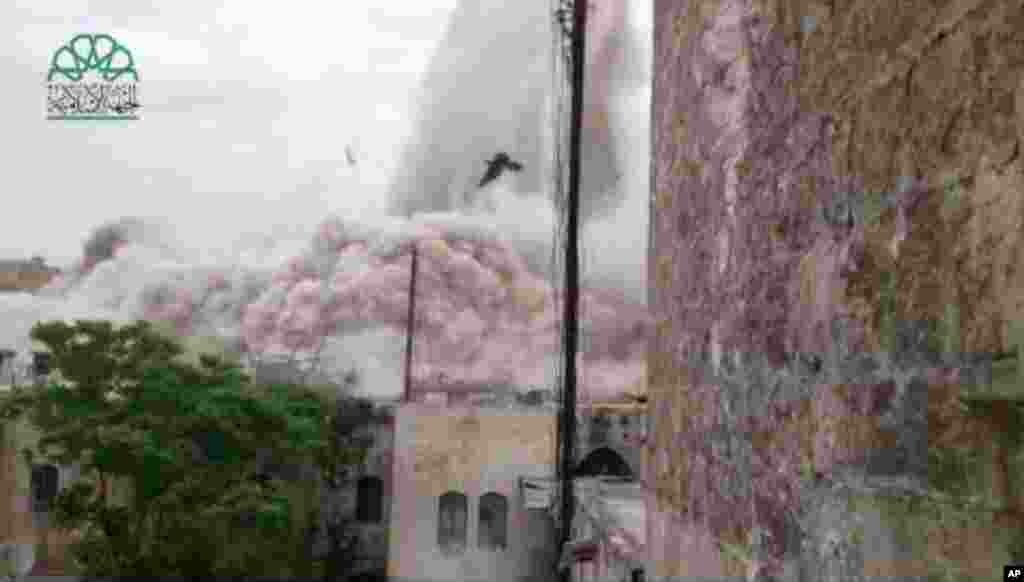 This scene taken from amateur video shows the explosion that destroyed the Carlton Hotel in Aleppo, May 8, 2014.