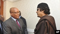 South Africa's President Jacob Zuma greets Libyan leader Moammar Gadhafi before their meeting in Tripoli