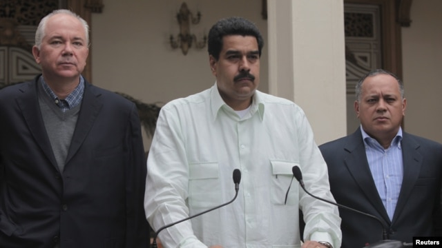 Venezuela's Vice President Nicolas Maduro (C), flanked by cabinet members, makes a statement about the health condition of Venezuela's President Hugo Chavez during a news conference in Caracas, December 12, 2012.
