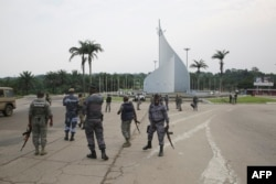 Gabonese gendarmes patrol on the Democracy square in Libreville, Jan. 7, 2018, after a group of soldiers sought to seize power in Gabon.