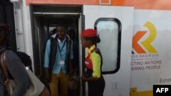 Passengers disembark upon arrival in a Mombasa-to-Nairobi train launched to operate on the Standard Gauge Railway (SGR), May 31, 2017.
