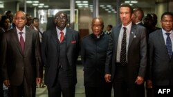 FILE: South African President Jacob Zuma (L), Zimbabwean President Robert Mugabe (2nd L), Lesotho Prime Minister Tom Thabane (C) and Botswana President Ian Khama (2nd R) stand for a group photo following an emergency meeting on the current situation in Lesotho.