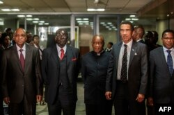 South African President Jacob Zuma (L), Zimbabwean President Robert Mugabe (2nd L), Lesotho Prime Minister Tom Thabane (C) and Botswana President Ian Khama (2nd R) stand for a group photo following an emergency meeting on the situation in Lesotho.