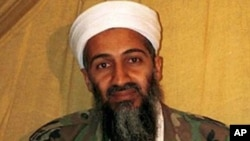 Osama bin Laden...** FILE ** This is an undated file photo of al Qaida leader Osama bin Laden, in Afghanistan. Bin Laden has issued a new audiotape urging Muslims to launch a jihad, or holy war, to stop the Israeli offensive in Gaza. The authenticity