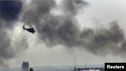 عکس آرشوی از یک هلیکوپتر نظامی اوکراین در حین سرکوب مخالفان در شهر دونتسک، در شرق آن کشور
