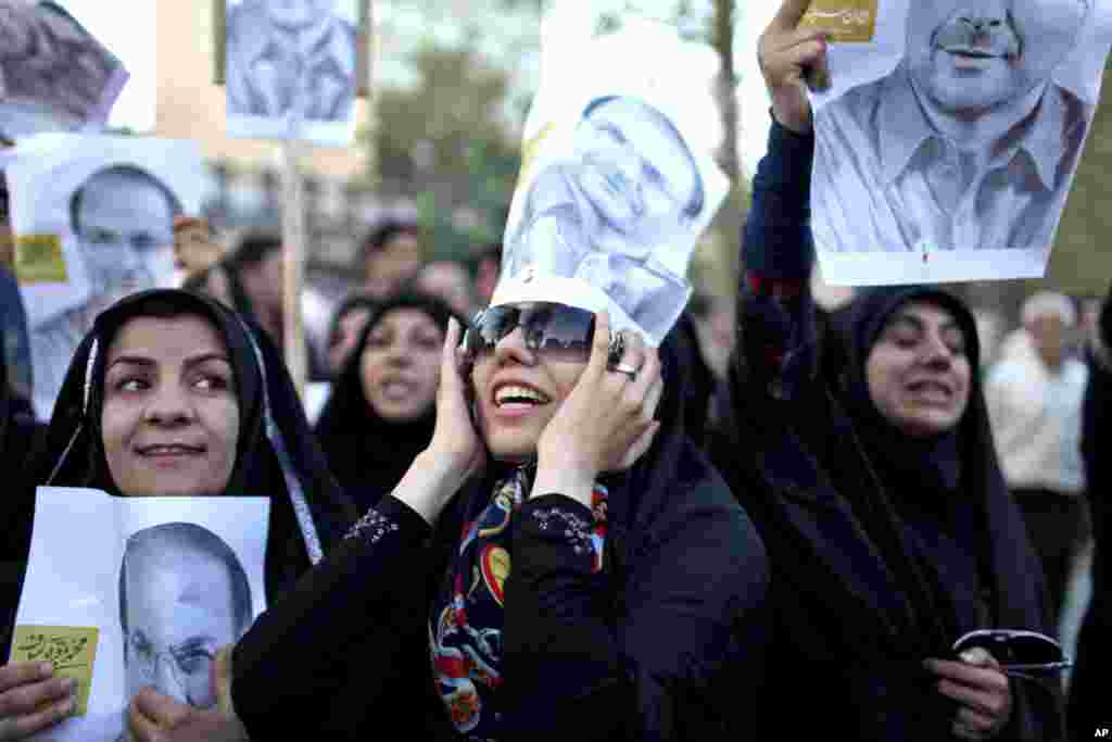 Supporters of Iranian presidential candidate Mohammad Bagher Qalibaf, who is also Tehran's mayor, chant during a street campaign, Tehran, Iran, June 9, 2013.